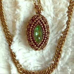 Double strand gold tone necklace with green stone